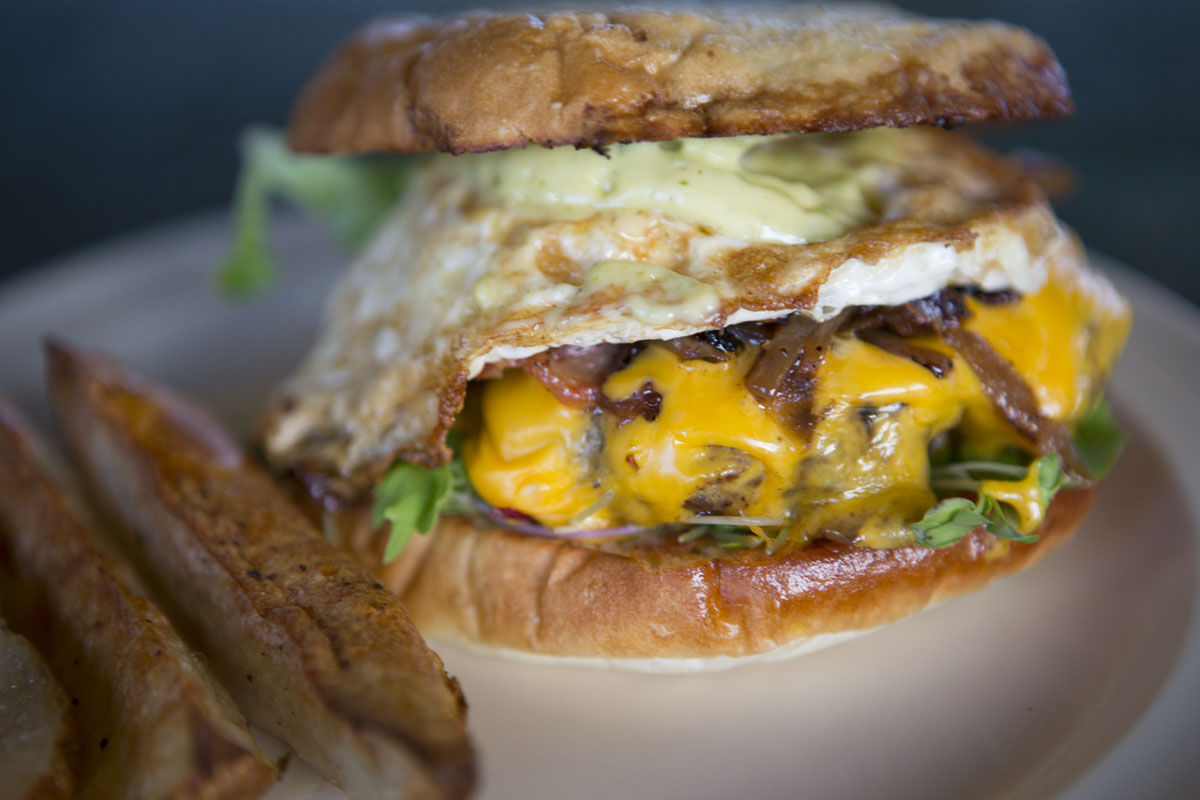 Farmer John Burger is a stable menu item in our farm to table dining pavilion using our pasture raised eggs certified organic vegetables and pasture raised bacon and pasture raised grass-fed ground beef