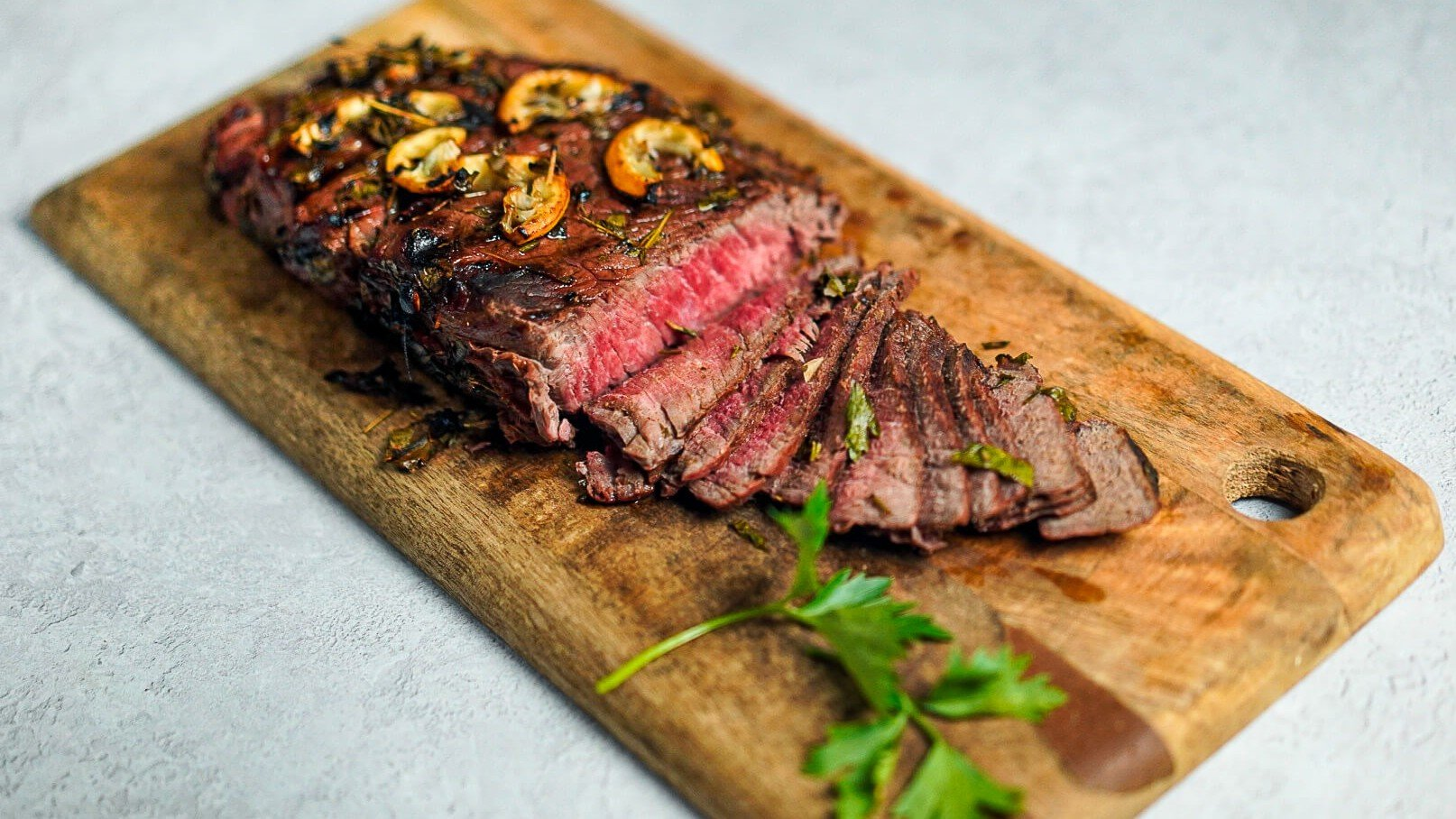 Grassfed London Broil marinated cooked cut