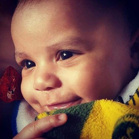 Baby Jonah borns to Jontavious Rodgers who works on the White Oak Pastures Hog Farrowing Crew