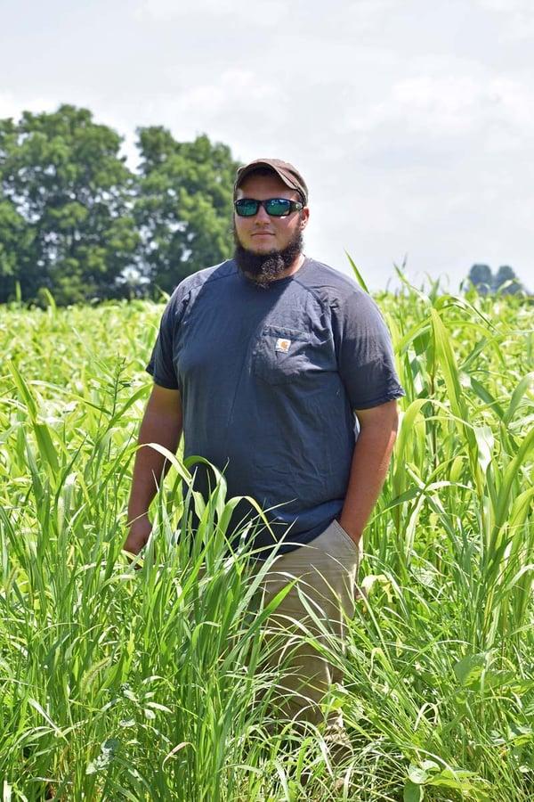 White Oak Pastures intern Dylan DeSutter at his family farm in Attica Indiana