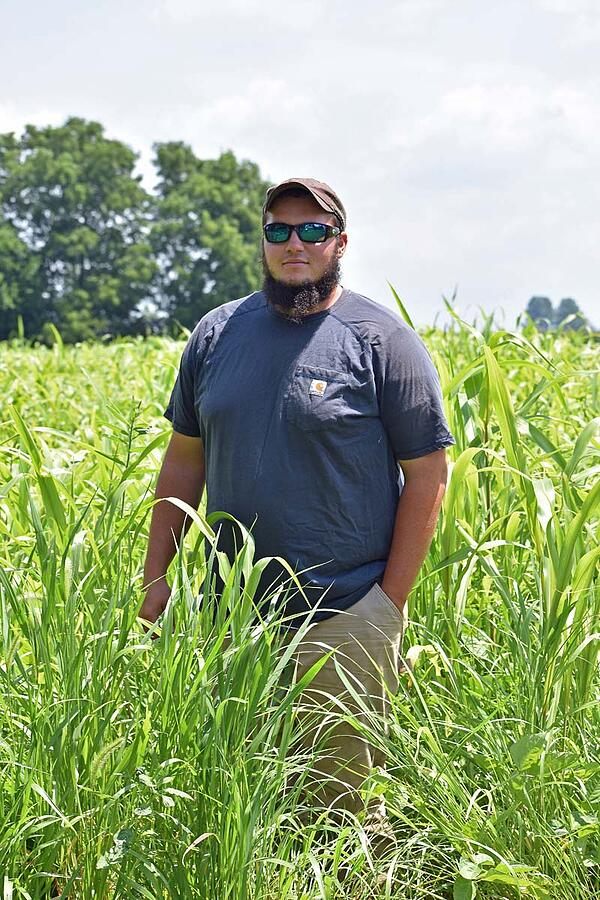White Oak Pastures intern Dylan DeSutter at his family farm in Attica Indiana