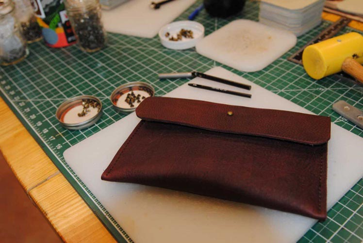 Learn to make a leather clutch at our workshop