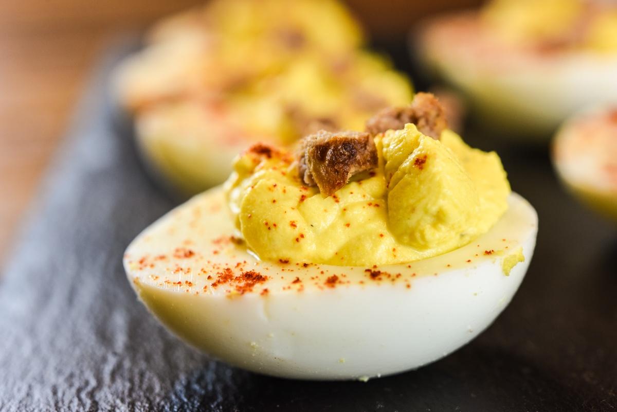deviled eggs using pasture raised noncom eggs local hot sauce and pasture raised nongmo pork sausage