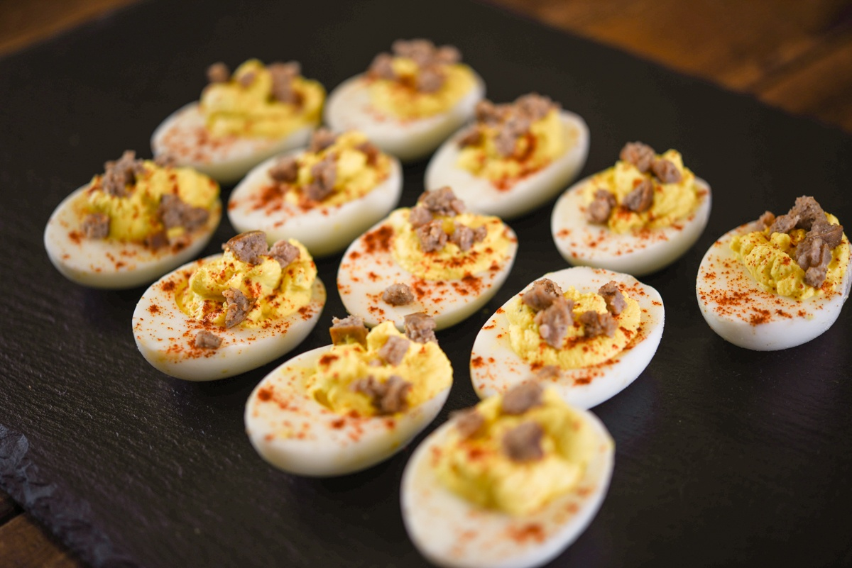 cajun deviled eggs with pasture raised eggs, pasture raised pork sausage, and a local hot sauce