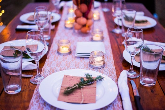 Dinner in the pasture under the stars by candlelight with lace and burlap runner local wine and pasture raised farm protein