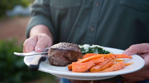 grassfed-steak-carrot-plate-dinner-knife-fork