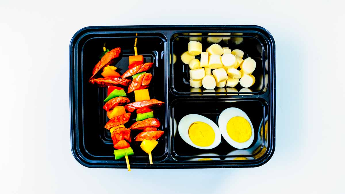 Pasture-raised kids lunch of natural cured hot dog skewers with vegetables