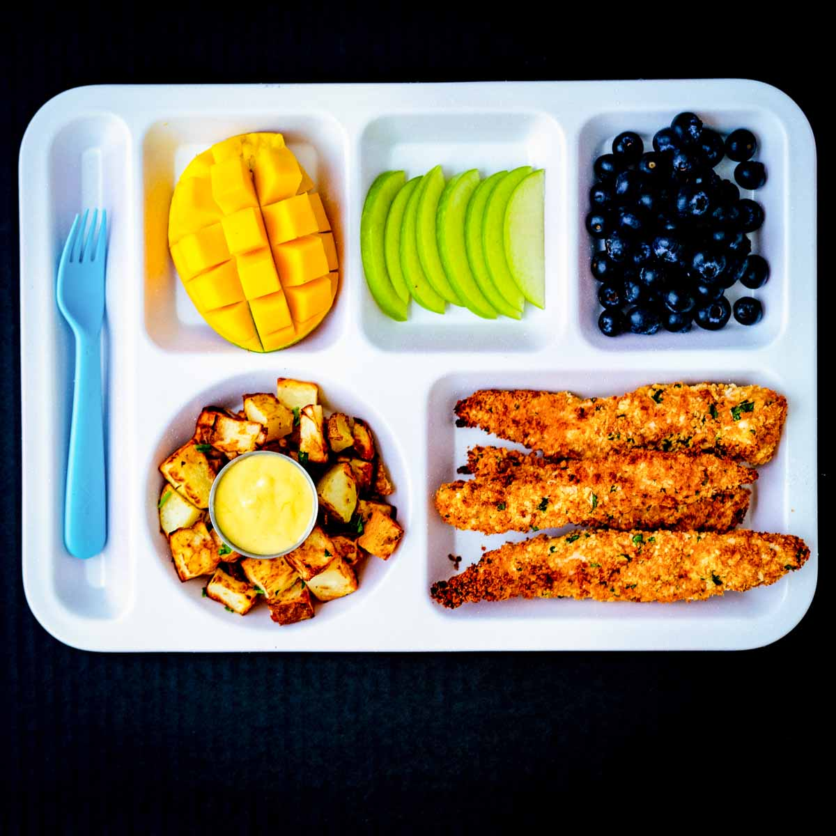 A healthy kids lunch with homemade pasture-raised chicken tenders.