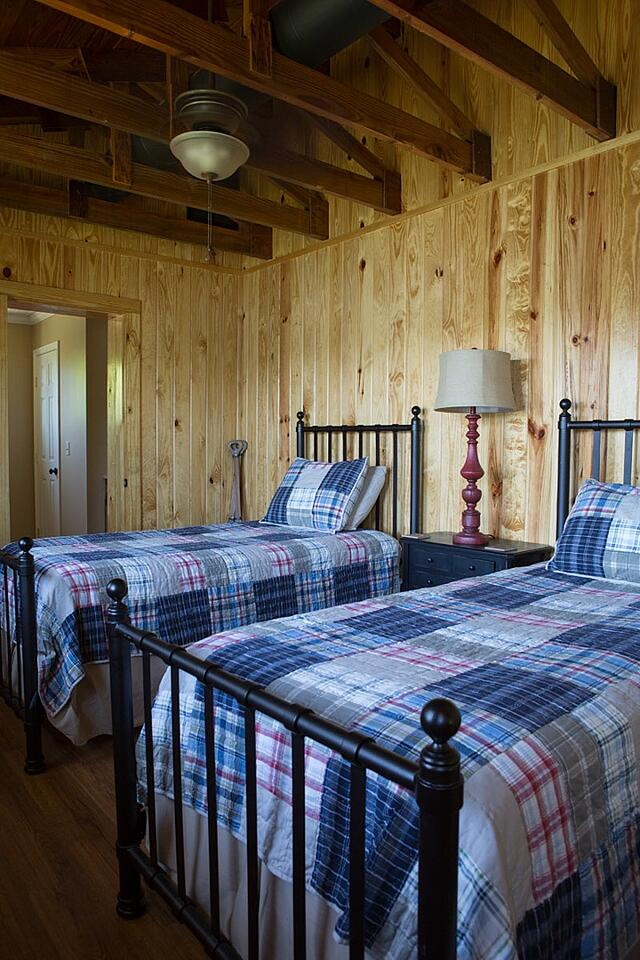 Pond house room 2 with two twin beds and plaid comforters.