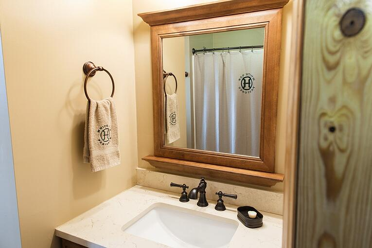 Bathroom with monogrammed towel and complimentary home made tallow soap.