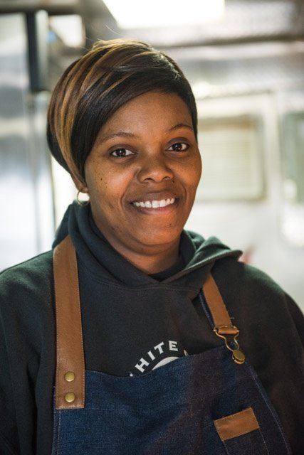 Shona serves breakfast lunch and dinner from the food truck and dining pavillion.jpg