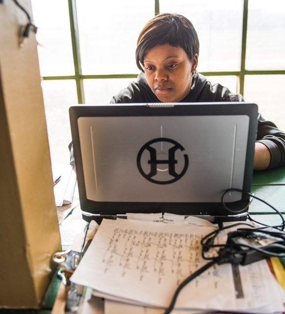 Lashona Butler keeping track of the records for our farm to table dining pavilion and food truck.jpg