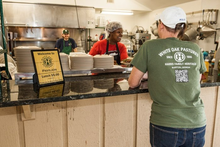shona working the lunch line to serve our 140 employees a hot pasture raised meal.jpg