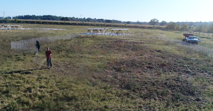 Tre Cates gets arial drone footage of fence being set up at White Oak Pastures