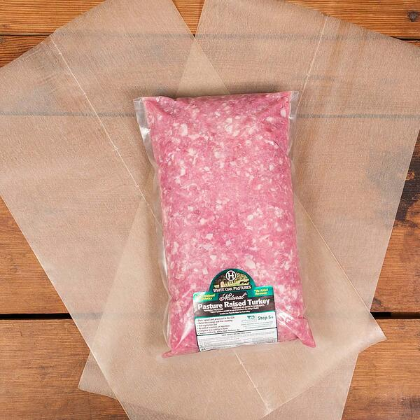 White Oak Pastures past green foil packaging for pasture raised ground turkey.