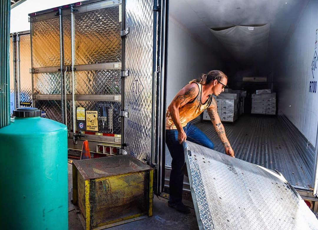 Loading Dock Manager Bubba Jackson loading freezer trucks for wholesale orders.jpg